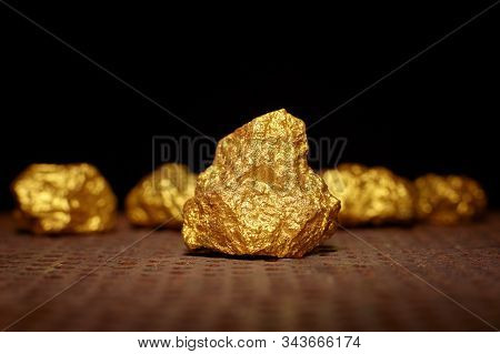 Closeup Of Big Gold Nugget. Finance And Business Concept. Gold Ore Found In The Mine. Trade And Exch