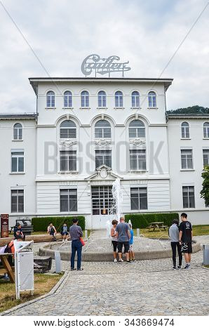 Broc, Switzerland - July 27, 2019: People Waiting In Front Of The Building Of The Famous Cailler Cho