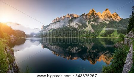 Fantastic azure alpine lake Vorderer Gosausee. Location place of Salzkammergut is a famous resort area located in the Gosau Valley in Upper Austria. Dachstein glacier. Discover the beauty of earth.