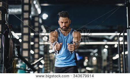 Young Athlete Training Triceps On Block Exerciser In Gym, Panorama