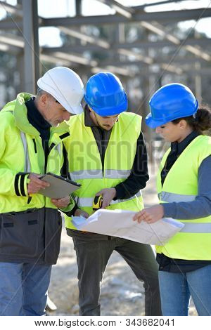Apprentices with instructor on building site