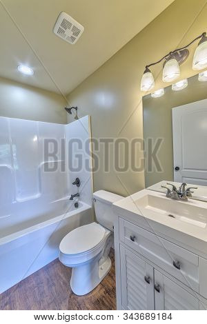Vertical Shot Of A Small Bathroom In A New Inexpensive Tract Home.