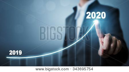 Business Development To Success In 2020 Concept. Businessman Pointing Arrow Graph Corporate Future G