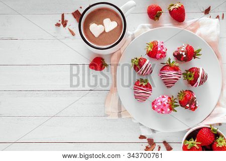 Valentines Day Chocolate Dipped Strawberries. Top View Table Scene Against A Dark Stone Background.