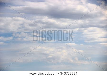 Cloudy Sky Background. After The Rain. Blue Sky Covered With Gray Clouds.