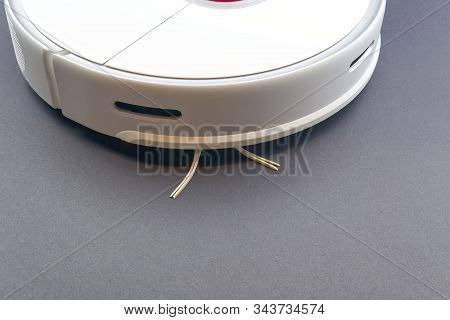 Robot Vacuum Cleaner Isolated On Grey Background, Close Up Photo