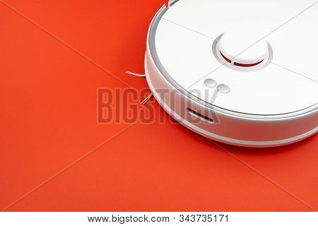Robot Vacuum Cleaner Isolated On Red Background, Close Up Photo. Close Up Photo