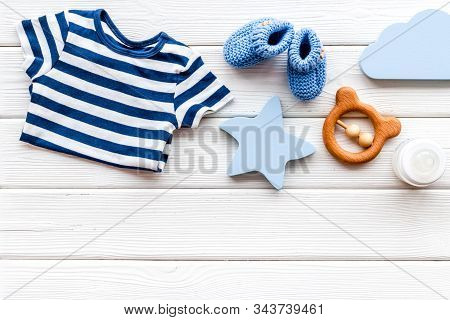 Baby Background - Blue Color. Clothes And Accessories For Newborn Boy On White Wooden Table Top-down