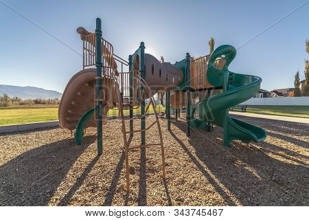 Colorful Twisted Slides In A Kids Playground