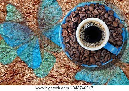 Brazilian Coffee. Blue Cup Of Coffee With Roasted Coffee Beans On A Saucer. Cup Of Coffee On A Golde