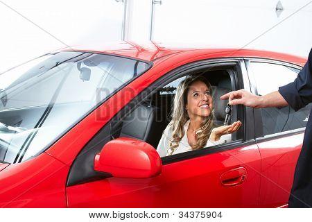 Auto mechanic and a client woman. Car repair service.