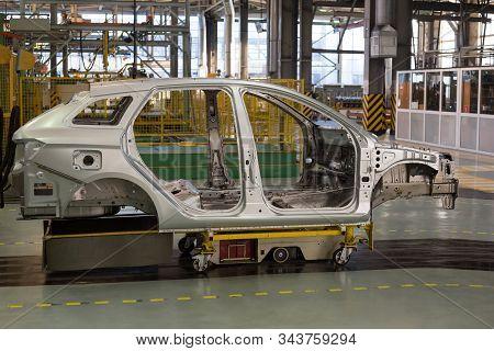 Russia, Izhevsk - December 14, 2019: Lada Automobile Plant Izhevsk. Frame Construction Of New Car St