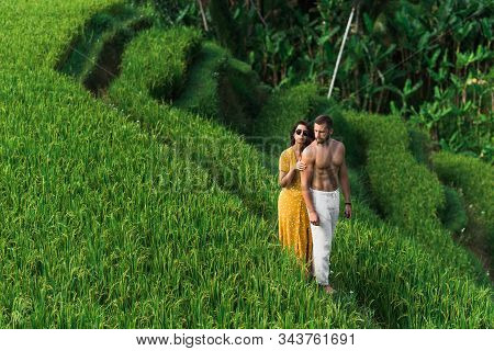A Couple In Love Travels Through Asia. Man And Woman Are Traveling In Bali. Honeymoon Trip. Happy Co