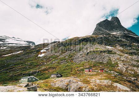 Trollstigen, Andalsnes, Norway. Wooden Houses In Mountains Landscape Near Road Trollstigen. Norwegia