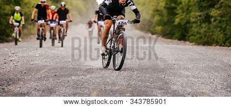 Cyclist Rider At Head Of Peloton Cross-country Mountain Bike Race