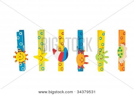 Colorful Clothespins With Wooden Figures Standing In A Row