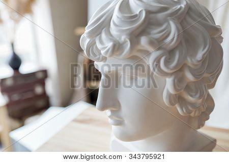 Renaissance Epoch. Gypsum Statue Of Apollo's Head. Man. Statue. Isolated. Head.