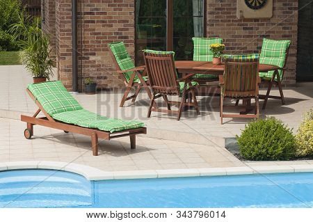 The Wooden Garden Furniture By The Pool