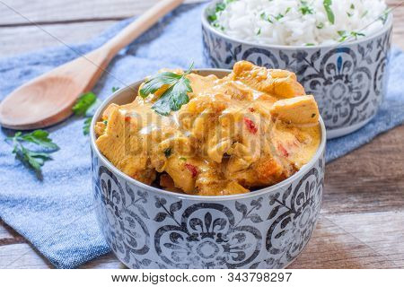 Chicken Curry Masala Style With Coriander On Pot