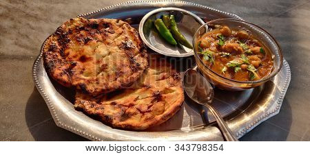 Spicy Chick Peas Curry Or Chola Or Chana Masala Or Chole Kulche Garnished With Green Chili Or Corian