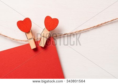 Couple Love Symbol. Clothes Pegs With Red Wooden Hearts. Valentines Day Background, Copy Space. Symb