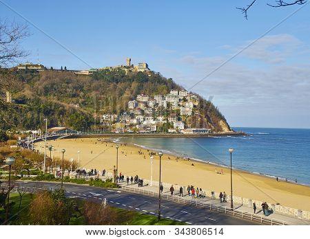 San Sebastian, Spain - January 1, 2020.the Ondarreta Beach With The Monte Igueldo In The Background