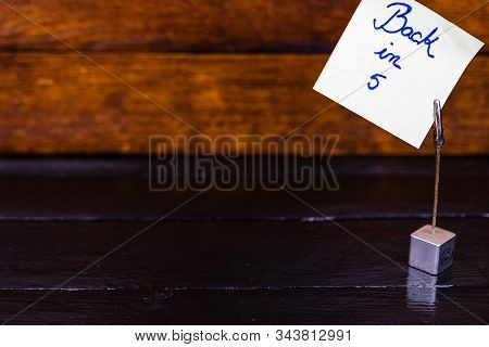Square Memo Holder With Memo Post Reminder. Writing Back In 5 On Paper. Bucharest, Romania, 2020.