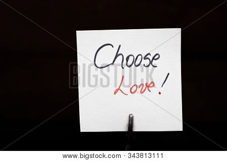 Memo Holder With Memo Post Reminder. Writing Choose Love On Paper. Bucharest, Romania, 2020.
