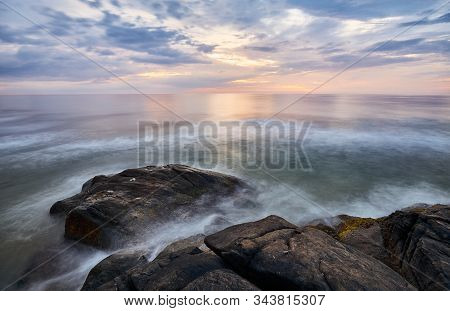 Scenic Sunset Over Water Seen From Rocky Shore, Long Time Exposure, Sri Lanka West Coast.
