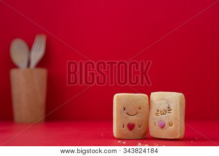 Copy Space On Red Valentines Background With Couple Cookie.