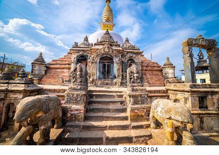 Sacred Gompa. Sculptures Of Gods And Goddesses Carved On The Stone Of Ancient Buddhist Temple And An
