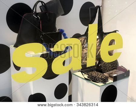 Sale Text On Store Window Display. 50% Sales Sign. Female Shop. Female Clothes