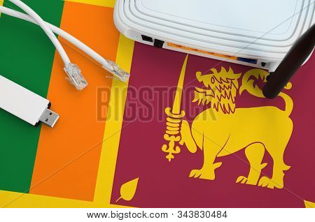 Sri Lanka Flag Depicted On Table With Internet Rj45 Cable, Wireless Usb Wifi Adapter And Router. Int