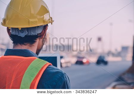 Rear View, Road Construction Engineer On Site
