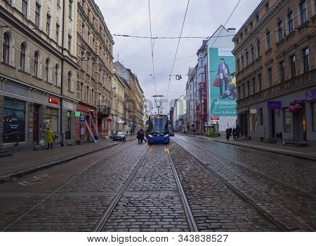 View Of Half Empty Street Of Old Riga After Rain. View Of The Carriageway And Cobblestone Pavement.