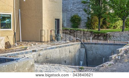 Pano Construction Of A Residential Swimming Pool With Houses And Trees Background