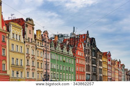 Wroclaw Old Town Houses In Poland, Europe. Blue Cloudy Sky In Background