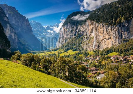 Summer view of alpine valley of Lauterbrunnen. Location place Swiss alp, Bernese Oberland, Europe. Staubbach waterfall is a famous tourist attraction. Natural wallpaper. Discover the world of beauty.
