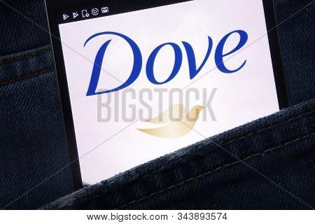 Konskie, Poland - May 17, 2018: Dove Website Displayed On Smartphone Hidden In Jeans Pocket
