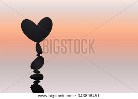 Heart And Stone Balancing, Rock Stacking, Love Symbol Naturally Balanced On Top. Silhouettes With Re