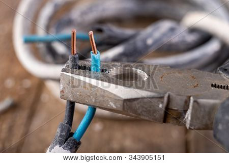 Old Copper Electric Wire And Combination Pliers. Electrical Installation Repair.