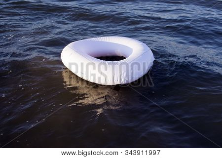 White Flotation Ring On Blue Sea, Concept, Safety On Water, Life Saver