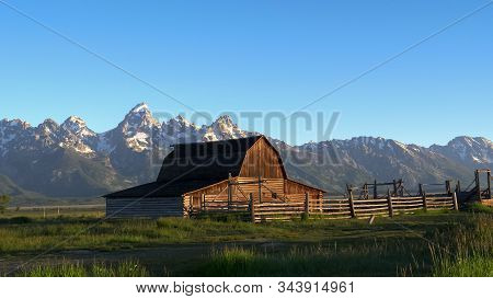 Grand Teton And A Barn At Sunrise In Wyoming