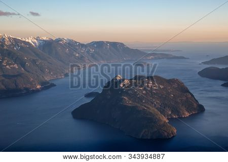 Aerial View Of Canadian Mountain Landscape During A Vibrant Sunset. Taken In Howe Sound Near Squamis
