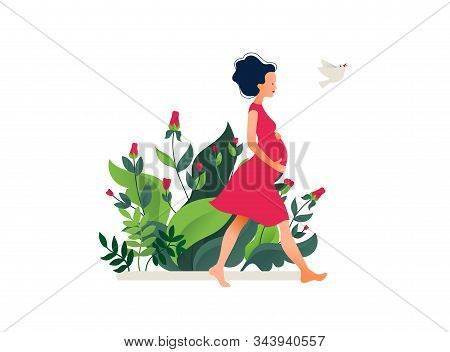 Happy Young Pregnant Woman Walking In The Beautiful Garden. Active Well Fitted Pregnant Female Chara