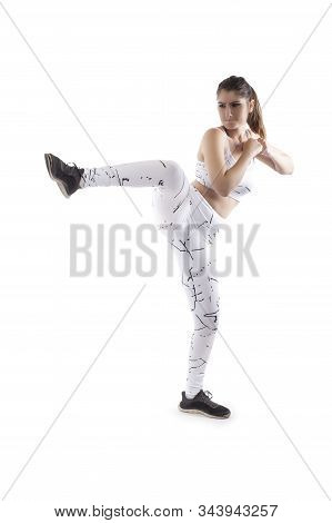 Woman Balancing While Kicking.  She Is Training For Kick Boxing Or Mma Combat Sport Or Working Out W