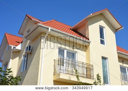 House With Attic, Metal Roof And Roof Gutter Outdoor. Home Guttering, Balcony,  Roof Gutters, Plasti