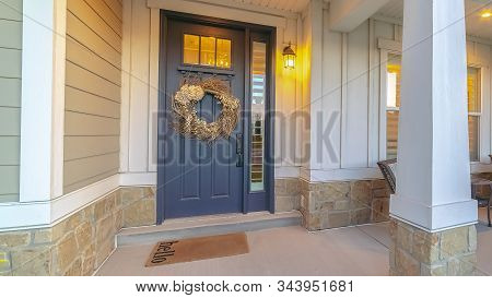 Panorama Front And Sidelight Of Home With Front Porch And Wood Siding Exetrior Wall