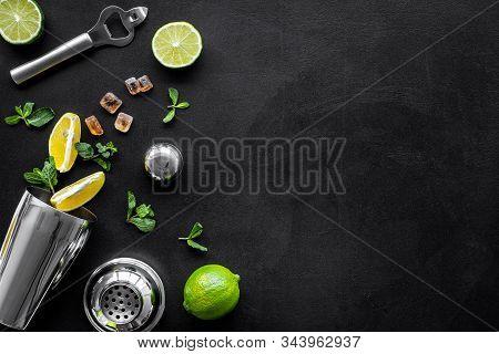 Bartender Work Desk, Equipment And Cocktail Ingredietns Shaker, Lime, Ice On Black Background Top-do