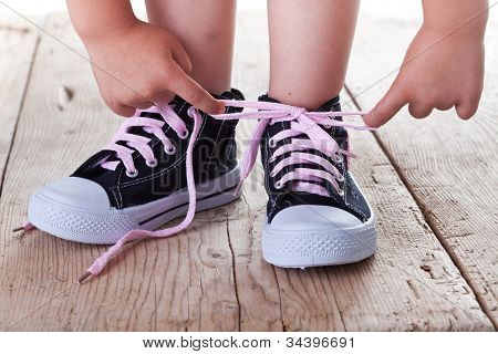 Child Successfully Ties Shoes